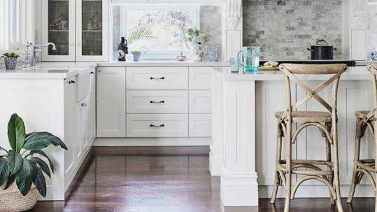 Hamptons reno kitchen with dark timber flooring